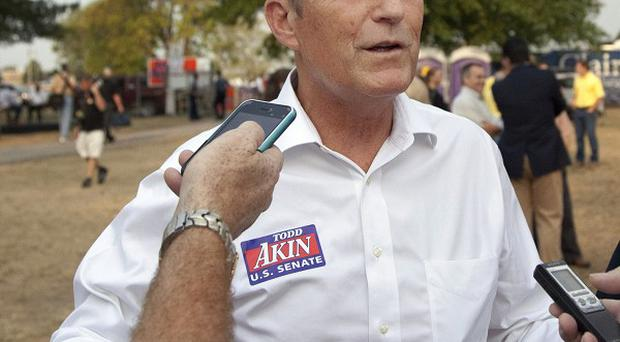 US politician Todd Akin has refused to abandon his election hopes (AP)