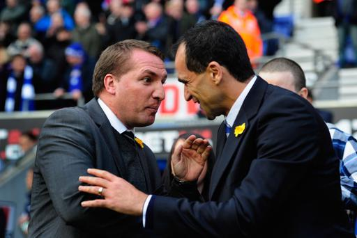 Brendan Rodgers (left) greets Wigan counterpart Roberto Martinez before the Barclays Premier League match between Wigan Athletic and Swansea City at DW Stadium on March 3, 2012. Rodgers left Swansea for Liverpool but Martinez was also linked with the Anfield job