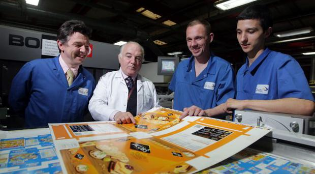 Delta Print managing director Terry Cross with young apprentices Kirean Magill and Jason Ali and the company's HR manager Fergal Doyle