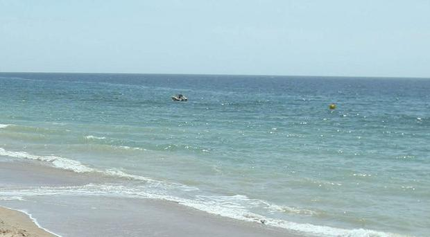 A five-year-old girl and her grandfather have drowned in waters off a Portuguese beach