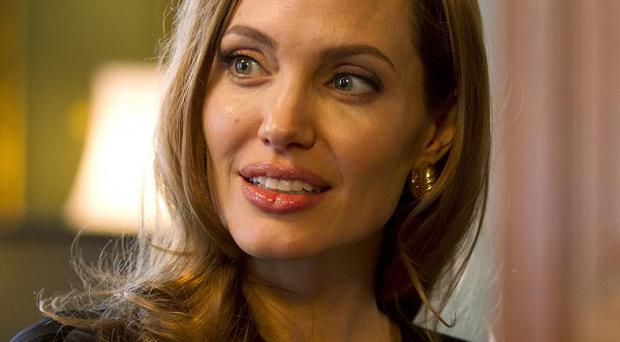 Angelina Jolie's youngest daughter, Vivienne, will play a 'minor role' alongside her mother in the film Maleficent