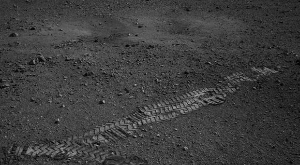 The Curiosity rover's wheel tracks can be seen on the surface of Mars (AP/Nasa)