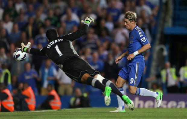 Chelsea's Fernando Torres (right) scores their third goal of the game during the Barclays Premier League match at Stamford Bridge, London