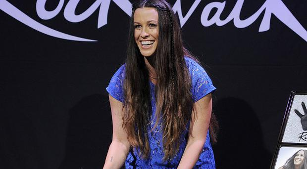 Singer Alanis Morissette at her RockWalk induction ceremony in LA
