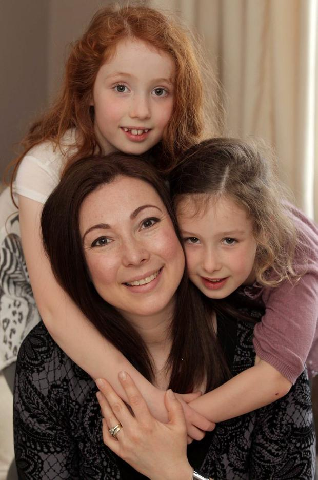 Tammy Thompson pictured at her home in Lurgan with her two daughters Nicole(7) (left) and Haley(5).