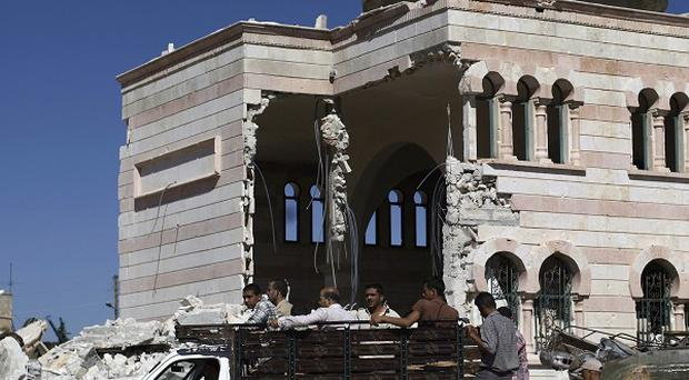 A damaged mosque in the city of Azaz, on the outskirts of Aleppo, as Assad's regime continues to attack the rebels (AP)