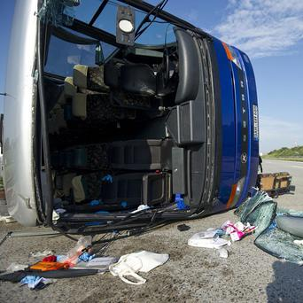 A bus has overturned on the highway near Freising, southern Germany, injuring at least 30 children (AP)