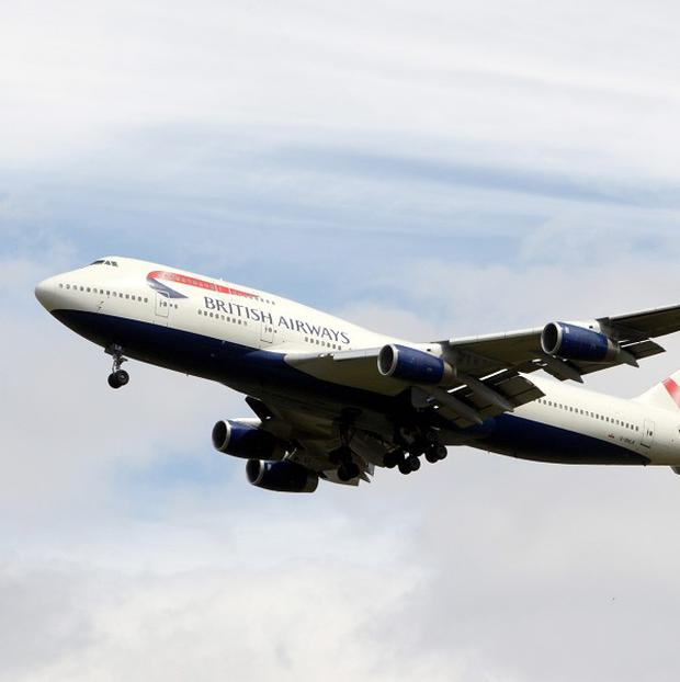 British Airways has said that a body has been found inside the landing gear bay of a Boeing 747 at Heathrow