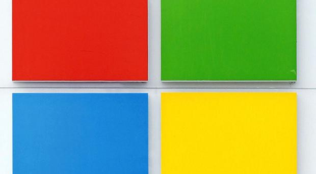 Microsoft has unveiled a new corporate logo (AP)