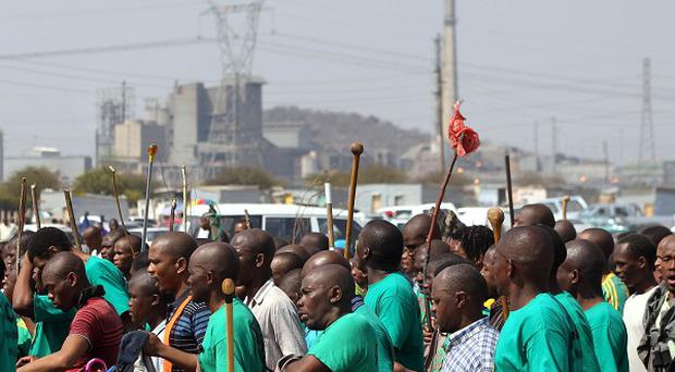 Mine workers attend a memorial service at the Lonmin Platinum Mine near Rustenburg, South Africa (AP)