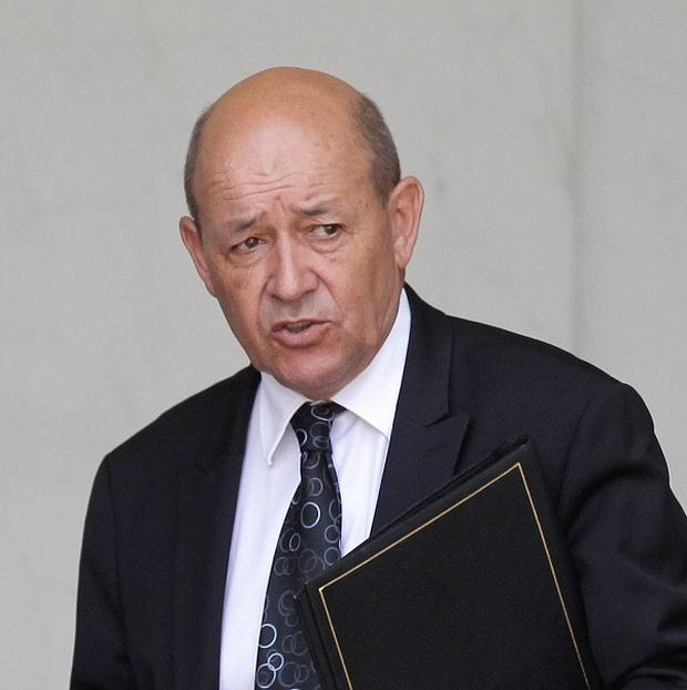 French defence minister Jean Yves Le Drian has called for international cooperation over a Syrian no-fly zone (AP)