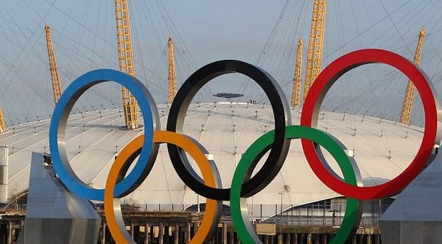 Allowing staff to watch the Olympics in the office has boosted productivity, a new survey of 1,000 managers has found