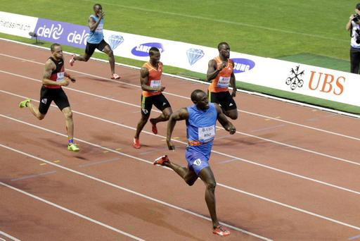 Usain Bolt from Jamaica, front, wins the men's 200-meter race at the Athletissima Diamond League Athletics Meeting in Lausanne, Switzerland, Thursday, Aug. 23, 2012. (AP Photo/Keystone, Salvatore Di Nolfi)