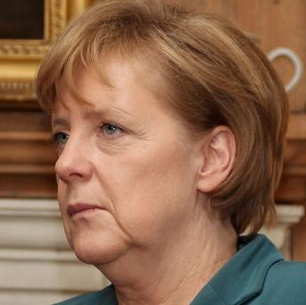 Police in Moldova have arrested a 23-year-old man on suspicion of throwing an incendiary device towards Angela Merkel's motorcade