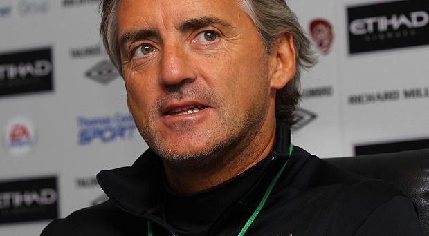 Roberto Mancini believes Liverpool will be tough to beat