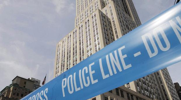 Police crime scene tape blocks 34th Street at Fifth Avenue after a multiple shooting outside the Empire State Building (AP)