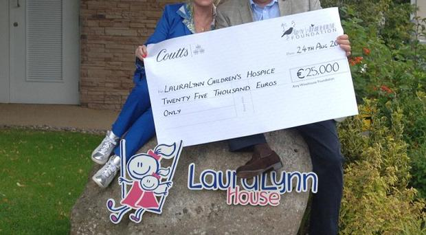 Mitch Winehouse and Barbara Windsor present a donation to the LauraLynn Children's Hospice in Dublin
