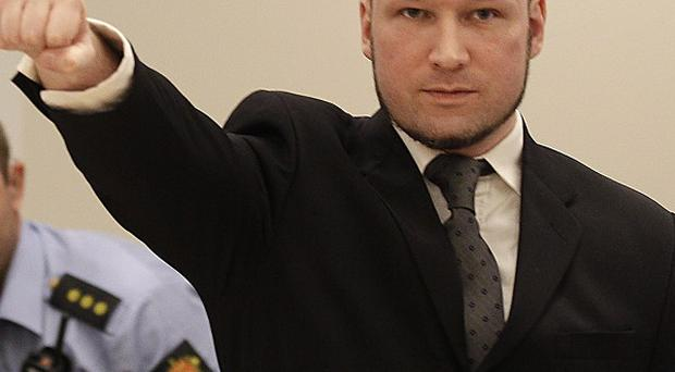 Anders Behring Breivik, who has been declared sane over killing 77 people last year, makes a salute in the courtroom in Oslo (AP)