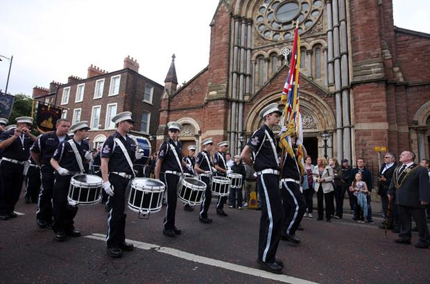 A loyalist band marches past St Patrick's Church. July 2012