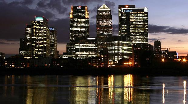 Five people got into difficulty on a stretch of the Thames near Canary Wharf, east London