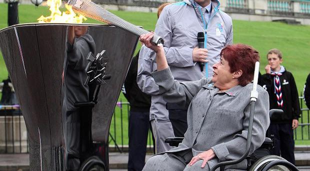 Angela Hendra MBE lights the Paraylmpic cauldron in the grounds of Stormont on Saturday