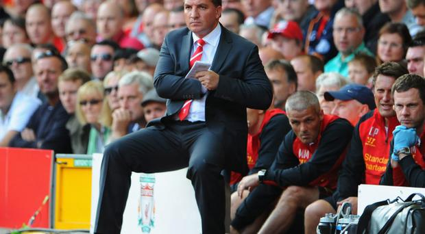 LIVERPOOL, ENGLAND - AUGUST 26: Liverpool Manager Brendan Rogers looks on during the Barclays Premier League match between Liverpool and Manchester City at Anfield on August 26, 2012 in Liverpool, England. (Photo by Michael Regan/Getty Images)
