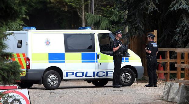 Police at Earls Hall Farm in St Osyth, near Clacton, Essex, where a lion was reportedly spotted