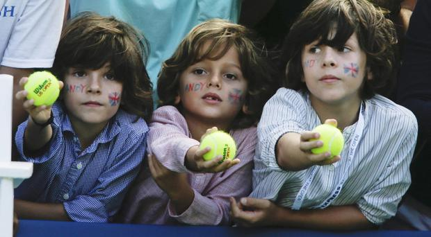 Young tennis fans wait to have their tennis balls signed by Britain's Andy Murray after he beat Alex Bogomolov Jr., of Russia, at the 2012 U.S. Open tennis tournament, Monday, Aug. 27, 2012, in New York. (AP Photo/Mike Groll)