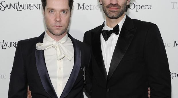 Singer Rufus Wainwright, left, has tied the knot with boyfriend Jorn Weisbrodt (AP)
