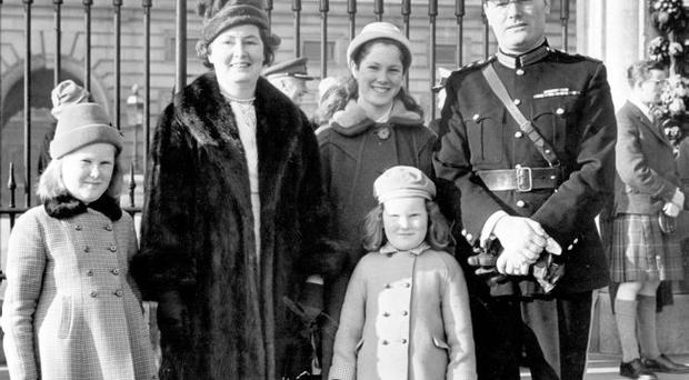 Colonel James Hughes, of Beechgrove Drive in Cregagh, Belfast, with his wife Aimee and daughters Rosalynd, Alison and Fiona outside Buckingham Palace after receiving the OBE from the Queen Mother on February 15, 1961