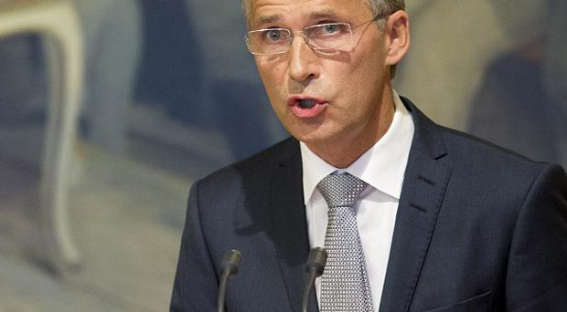 Norwegian prime minister Jens Stoltenberg has apologised for mistakes that let Anders Breivik kill 77 people (AP)