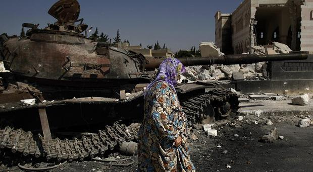 A Syrian government tank destroyed by rebels in Azaz, on the outskirts of Aleppo (AP)