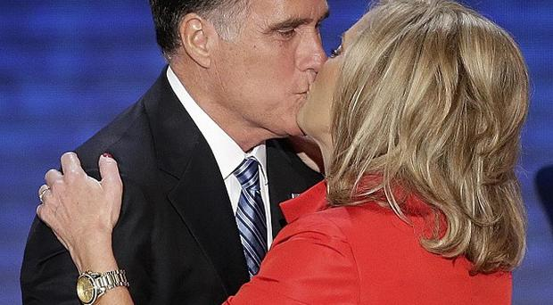 Ann Romney is kissed by her husband Republican presidential nominee Mitt Romney (AP/J Scott Applwhite)