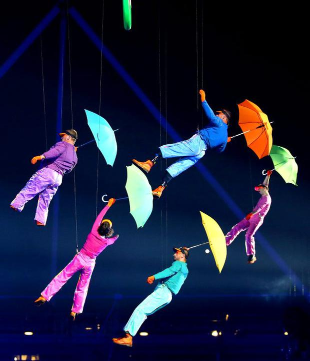 Artists perform with umbrellas during the Opening Ceremony of the London 2012 Paralympics at the Olympic Stadium on August 29, 2012