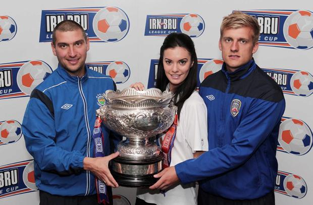 Irn Bru's Zara Shaw keeps Linfield's Matty Tipton (left) and Aaron Boyd of Coleraine apart as they aim to keep their hands on the League Cup