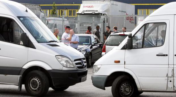 Sub-contractors block the entrance to a Target Express depot in Dublin as sacked employees staged a protest
