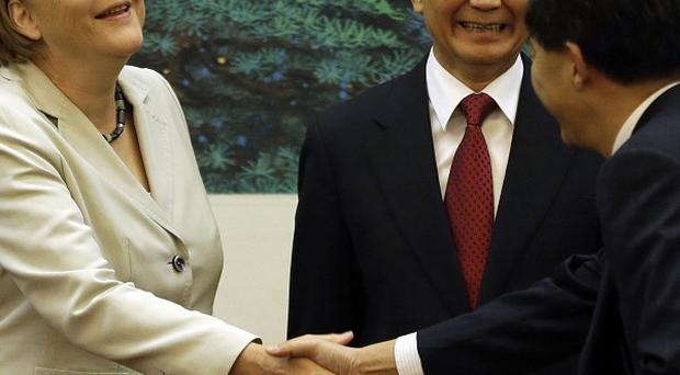 German chancellor Angela Merkel met with Chinese premier Wen Jiabao, centre, in Beijing for trade talks (AP)