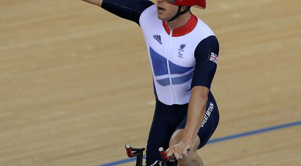 Great Britain's Mark Lee Colbourne waves to the crowd after winning a silver medal in the velodrome