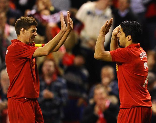 LIVERPOOL, ENGLAND - AUGUST 30: Steven Gerrard of Liverpool congratulates Luis Suarez on scoring during the UEFA Europa League play-off round second leg between Liverpool and Hearts at Anfield on August 30, 2012 in Liverpool, England. (Photo by Laurence Griffiths/Getty Images)