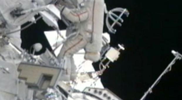 Astronauts have been replacing a power-switching unit on the International Space Station (AP/Nasa)