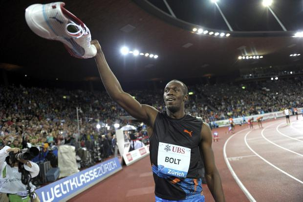 Usain Bolt from Jamaica reacts after winning the men's 200m race at the Diamond League Athletics meeting in Zurich, Switzerland, on Thursday, Aug. 30, 2012. (AP Photo/KEYSTONE,Steffen Schmidt)