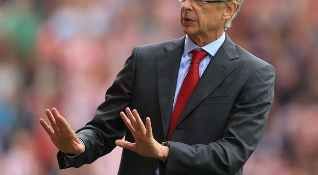 Arsene Wenger has defended Theo Walcott against accusations of greed