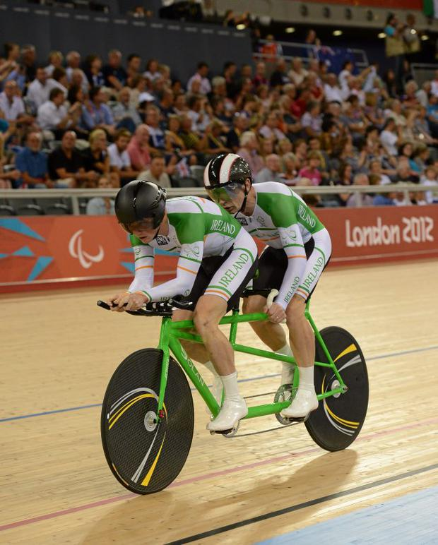 James and his tandem partner Damien Shaw in action in the men's individual B pursuit bronze medal final at the London Velodrome