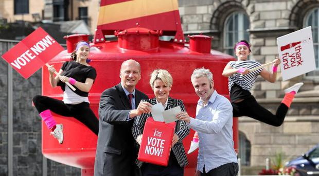Emma Gorman and Emma Woodward jump into action to help Maire Campbell, Public Affairs and Communications Director, Coca- Cola HBC, James Laverty, Northern Ireland Council for Voluntary Action (NICVA) and John Heaslip of Business in the Community NI, encourage members of the public to go online to www.coca-cola.ie and vote for their favourite organisation involved in promoting active lifestyles.