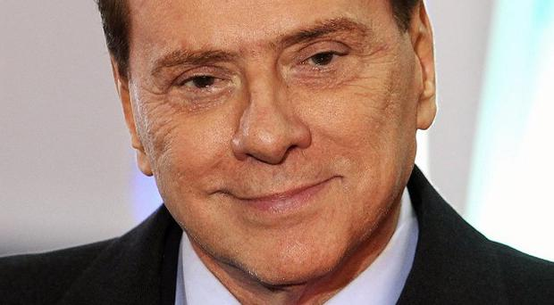 Silvio Berlusconi has dislocated a shoulder and injured a wrist in a fall on Sardinia