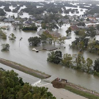 An intentional levy breach was created to alleviate trapped floodwater in the community of Braithwaite, Louisiana (AP/Gerald Herbert)