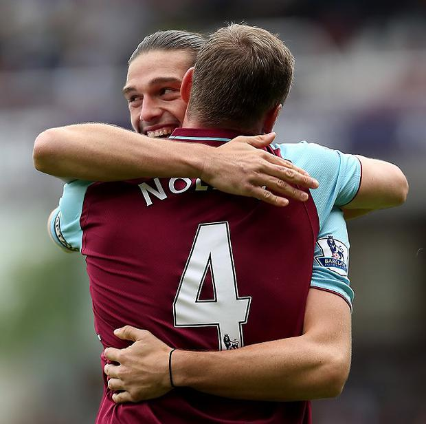 Kevin Nolan celebrates scoring the opening goal of the match with Andy Carroll