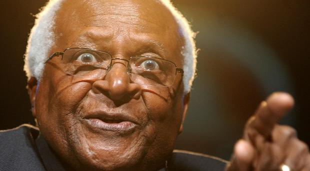 Archbishop Desmond Tutu said Tony Blair and George W Bush 'behaved like playground bullies' over the Iraq war