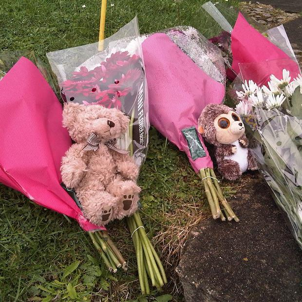 Flowers left at the scene where a man and two children have been found dead at an address in Tidworth