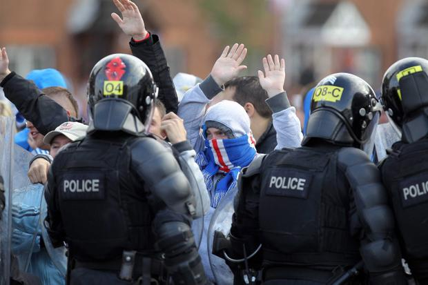 Young loyalists face police in north Belfast following a parade.